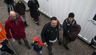 Uchodźcy w ośrodku