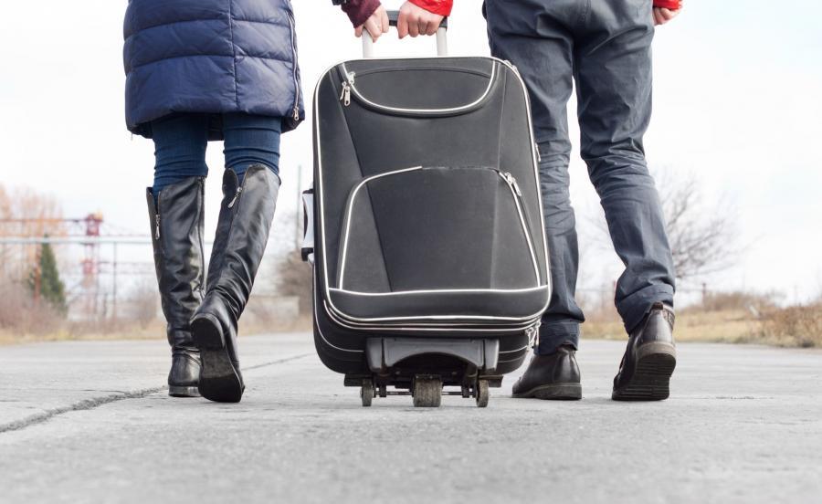 Ludzie z walizką